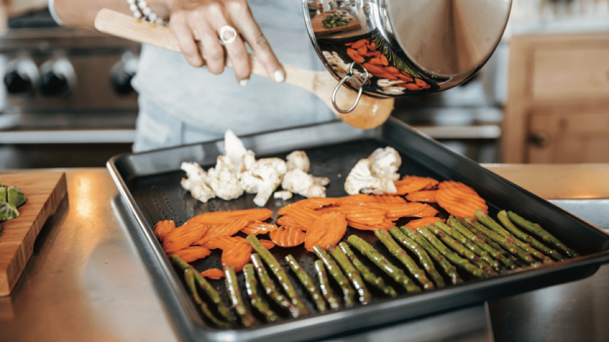 Carrie Underwood places seasonal vegetables on a pan to roast in the oven