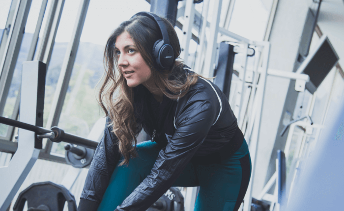 Woman at the gym listening to music on headphones