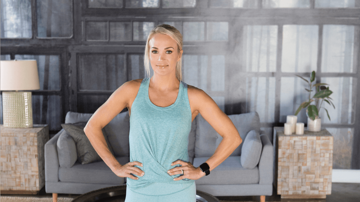 Carrie Underwood wearing Calia athletic wear standing in home gym