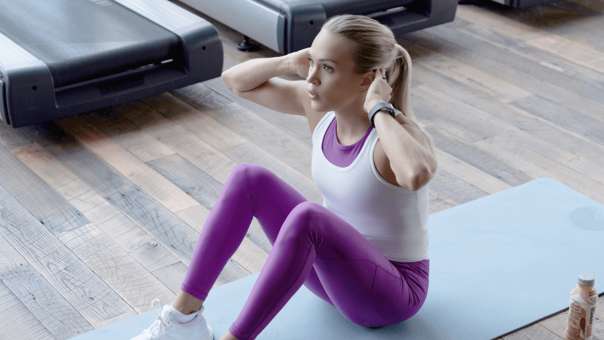 Carrie Underwood demonstrating sit-ups to strengthen your core